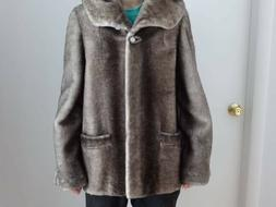 women natural fur coat made from sheared